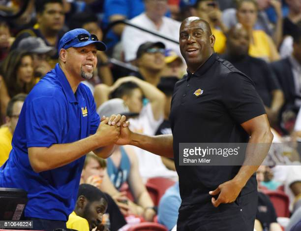 Assistant coach Tracy Murray of the Los Angeles Lakers talks with Lakers president of basketball operations Earvin 'Magic' Johnson during a 2017...