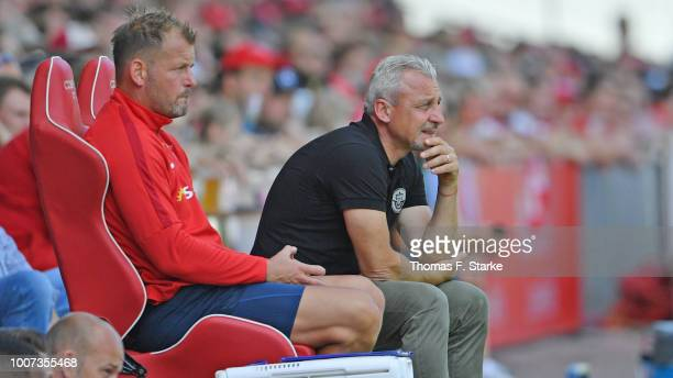 Assistant coach Uwe Ehlers and head coach Pavel Dotchev of Rostock watch their players during the 3. Liga match between FC Energie Cottbus and F.C....