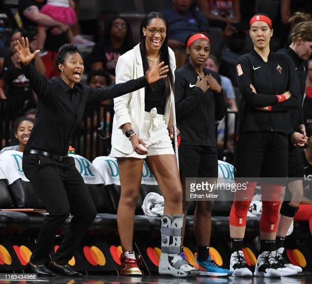 Assistant coach Vickie Johnson A'ja Wilson Jackie Young and JiSu Park of the Las Vegas Aces watch from the bench as the team takes on the Minnesota...