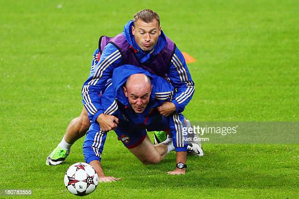 Assistant coach Viktor Onopko is challenged by Vasili Berezutski during a CSKA Moscow training session ahead of their UEFA Champions League Group D...