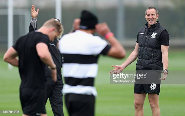 Assistant Coach Will Greenwood runs the players through the warm up during the Barbarians Training Session at Latymer Upper Sports Ground on November...