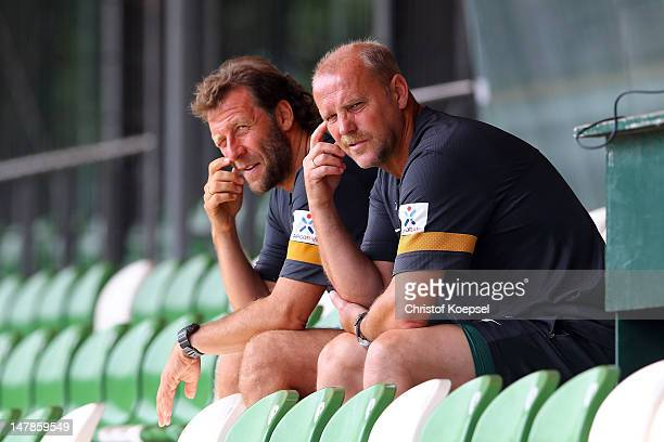 Assistant coach Wolfgang Rolff and head coach Thomas Schaaf of Bremen watch the blood testing at the training ground at Weser Stadium on July 5 2012...