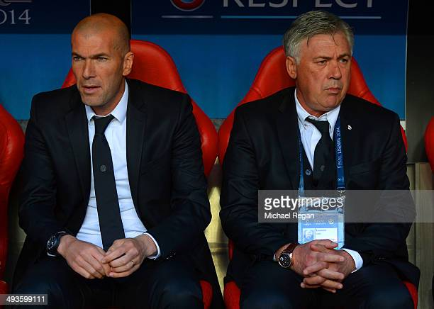 Assistant coach Zinedine Zidane of Real Madrid and Head Coach Carlo Ancelotti of Real Madrid look on during the UEFA Champions League Final between...