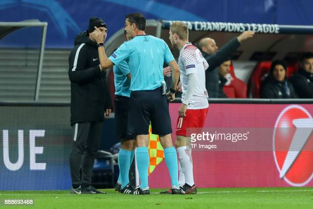 Assistant coach Zsolt Loew of Leipzig speak with Referee Viktor Kassai during the UEFA Champions League group G soccer match between RB Leipzig and...