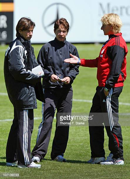 Assistant coaches Bettina Wiegmann and Silke Rottenberg and head coach Maren Meinert of Germany look on after the DFB Women's U20 friendly match...