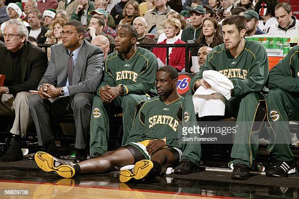 Assistant coaches Bob Hill and Ralph Lewis with Mateen Cleaves, Ronald Murray and Nick Collison of the Seattle SuperSonics sit on the bench as they...