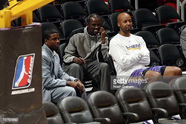 Assistant Coaches Brian Shaw and Craig Hodges of the Los Angeles Lakers sit in with current Laker Shammond Williams as the Los Angeles DFenders play...