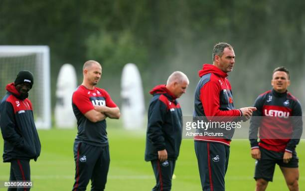Assistant coaches Claude Makelele Karl Halabi and Nigel Gibbs Swansea manager Paul Clement and Roque Mesa speak during the Swansea City Training and...