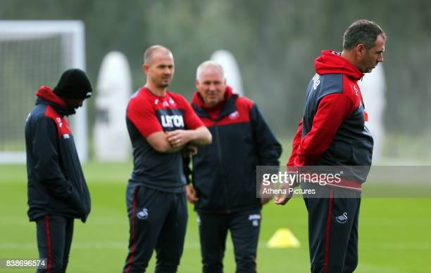 Assistant coaches Claude Makelele Karl Halabi Nigel Gibbs and Swansea manager Paul Clement speak during the Swansea City Training and Press...
