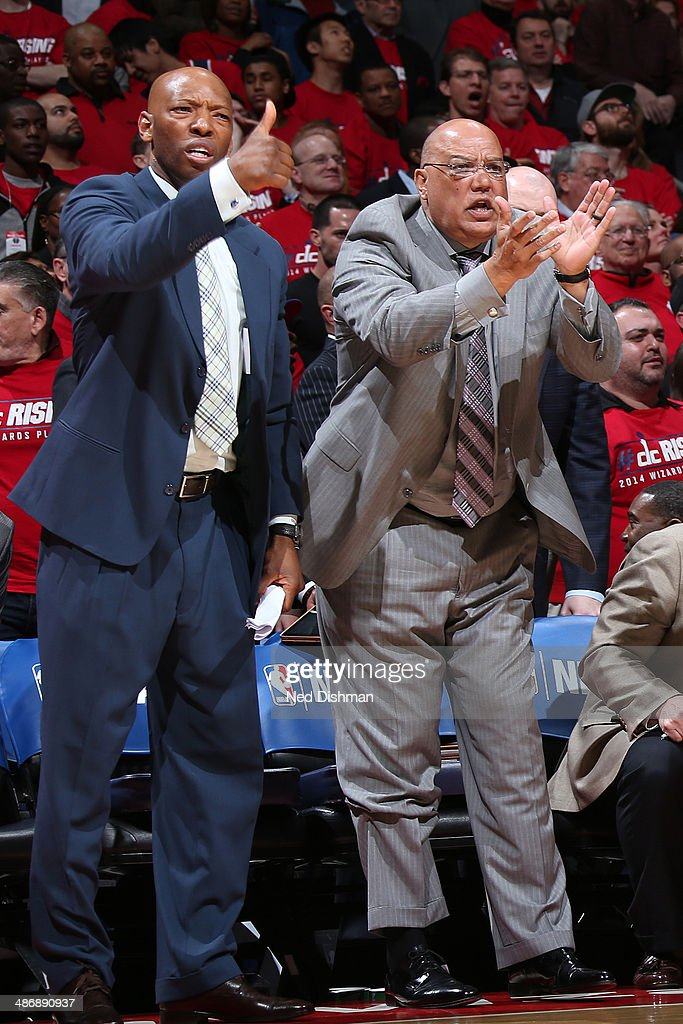 Assistant coaches Don Newman and Sam Cassell of the Washington Wizards celebrate during a game against the Chicago Bulls in Game Three of the Eastern Conference Quarterfinals during the 2014 NBA Playoffs at the Verizon Center on April 25, 2014 in Washington, DC.