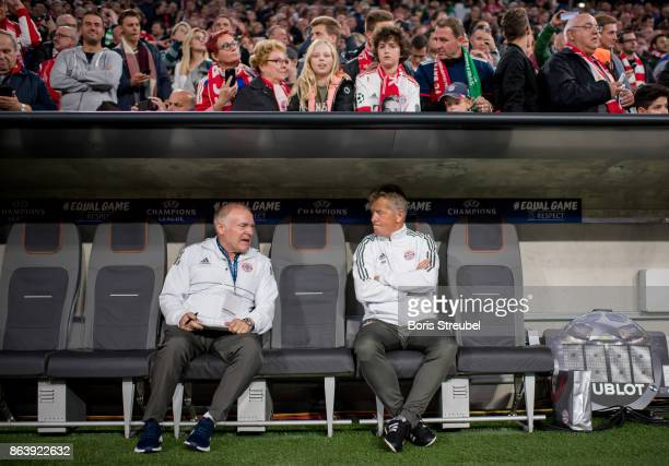 Assistant coaches Hermann Gerland and Peter Hermann look on prior to the UEFA Champions League group B match between Bayern Muenchen and Celtic FC at...