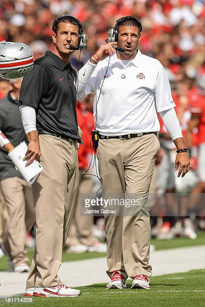 Assistant coaches Luke Fickell left and Mike Vrabel both of the Ohio State Buckeyes watch their team during a game against the Florida AM Rattlers at...