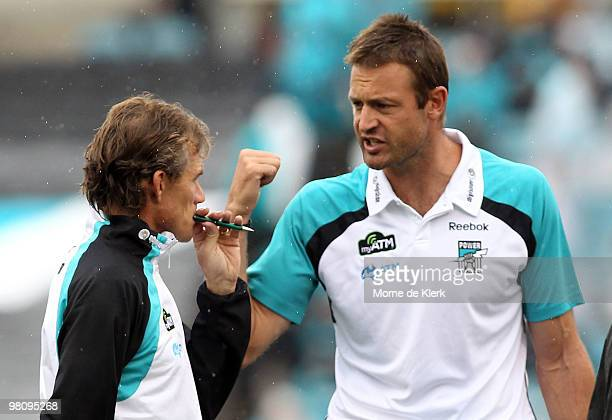 Assistant coaches Matthew Primus and Dean Laidley of the Power talk during the three quarter time break during the round one AFL match between the...