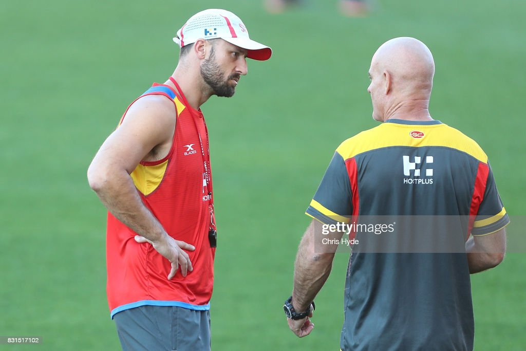 Assistant coaches Nick Malceski and Andy Lovell talk during a Gold Coast Suns AFL training session at Metricon Stadium on August 15, 2017 in Gold Coast, Australia.