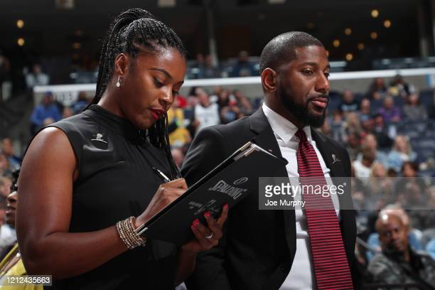 Assistant coaches Niele Ivey and Scoonie Penn of the Memphis Grizzlies looks on during the game on October 27 2019 at FedExForum in Memphis Tennessee...
