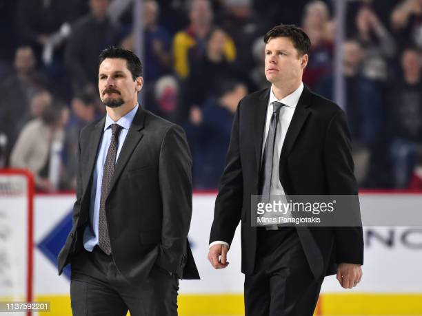 Assistant coaches of the Providence Bruins Trent Whitfield and Ryan Mougenel look on as they walk across the ice after their loss to the Laval Rocket...
