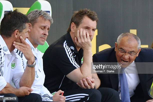 Assistant coaches Werner Leuthard, Pierre Littbarski, Bernd Hollerbach and head coach Felix Magath react during the Bundesliga match between VfL...