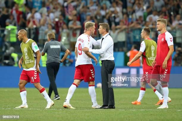 Assistant coachof Denmark John Dahl Toammson consoles Nicolai Jorgensen following the 2018 FIFA World Cup Russia Round of 16 match between Croatia...