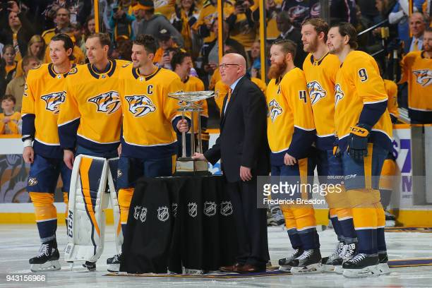 Assistant Commissioner Bill Daly presents the President's Trophy to the Nashville Predators prior to their final regular season game against the...