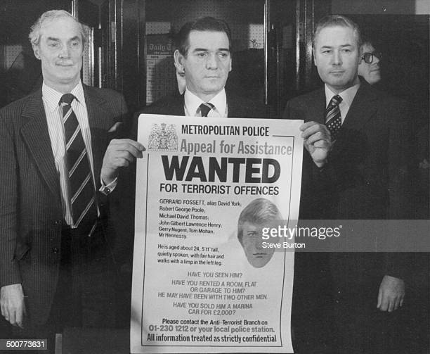 Assistant Commissioner Gilbert Kellard AntiTerrorist Chief Peter Duffy and Detective Chief Peter Phelan holding up a poster of escaped IRA terror...
