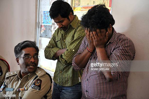 Assistant Commissioner of Police in Banjara Hills Ravindra Reddy looks at the suspected sex trafficking members of the online prostitution service...