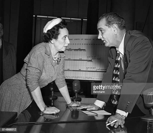 US Assistant Defense Secretary Anna Rosenberg and Chairman of the US Senate's Preparedness Committee Lyndon B Johnson discuss the Defense...