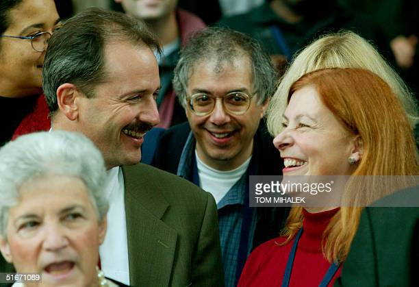 Assistant District Attorney Joel Rosen and Meg Wakeman one of the sisters of victim Holly Maddux smile as Philadelphia District Attorney Lynn Abraham...