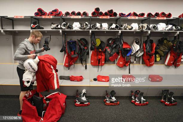 Assistant Equipment Manager Brady Munger of the Detroit Red Wings packs a stick bag after the Detroit Red Wings against the Washington Capitals game...