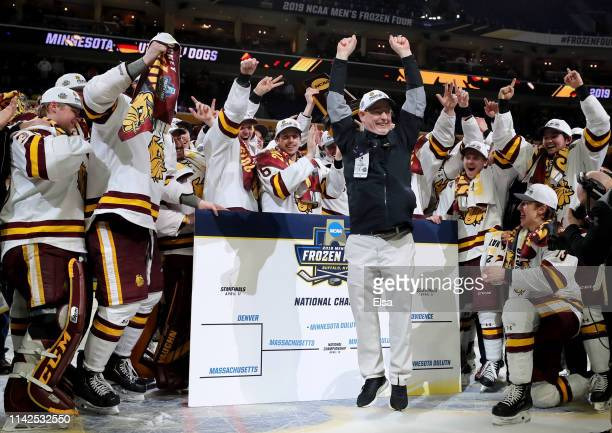 Assistant equipment manager Dale Haagenson of the Minnesota-Duluth Bulldogs celebrates after he places the team name in the championship spot on the...