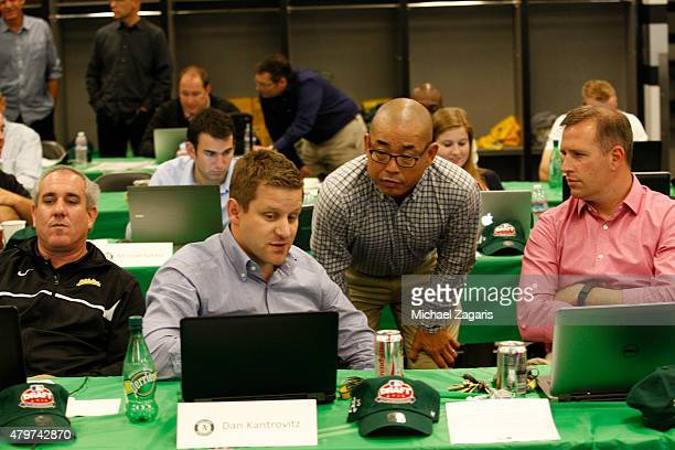 Assistant General Manager Dan Kantrovitz Director of Scouting Eric Kubota and Assistant General Manager David Forst of the Oakland Athletics talk in...