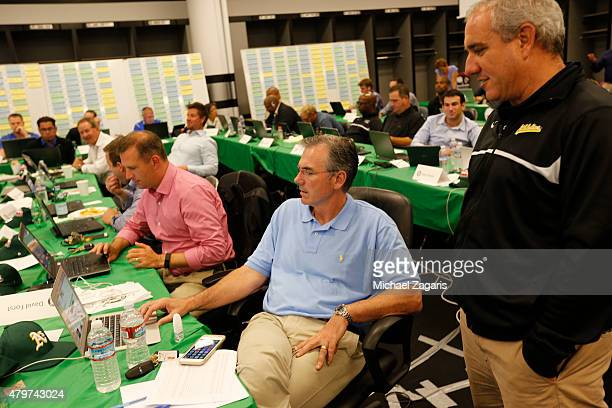 Assistant General Manager David Forst General Manager Billy Beane and Director of Professional Scouting/Baseball Development Dan Feinstein of the...