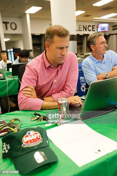 Assistant General Manager David Forst of the Oakland Athletics checks his computer in the Athletics draft room during the first day of the 2015 MLB...
