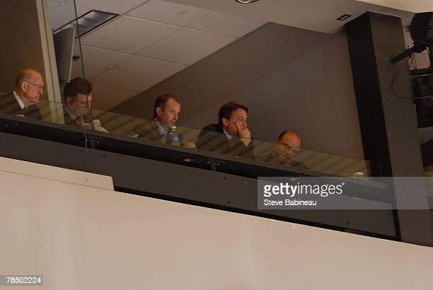 Assistant general manager Jim Benning executive vice president Charlie Jacobs vice president Cam Neely and general manager Peter Chiarelli of the...