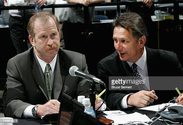 Assistant General Manager Jim Nill and General Manager Ken Holland attend the 2007 NHL Entry Draft at Nationwide Arena on June 23 2007 in Columbus...
