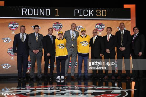 Assistant general manager Paul Fenton, general manager David Poile, director of player development Scott Nichol, draft runner, chief amateur scout...