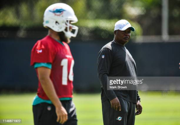 Assistant Head Coach Jim Caldwell of the Miami Dolphins coaches during practice drills during the third week OTAs at Baptist Health Training Facility...