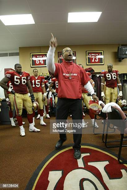 Assistant head coach/linebackers Mike Singletary of the San Francisco 49ers exhorts the team in the locker room at halftime during the NFL game...