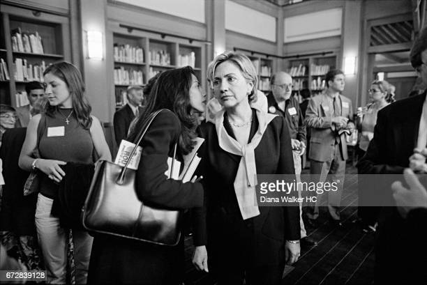 Assistant Huma Abedin delivers a message to Senator Hillary Rodham Clinton while she attending a fundraiser on July 28 2001 at the library in...