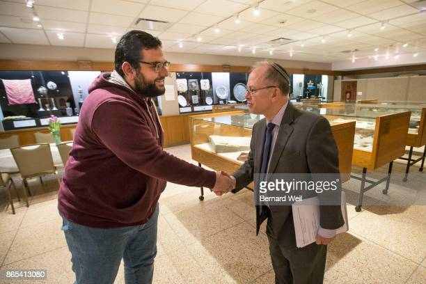 TORONTO ON MAY 10 Assistant Imam Ayman Elkasrawy met with Rabbi Baruch FrydmanKohl at Beth Tzedec synagogue to learn about the Jewish faith In...