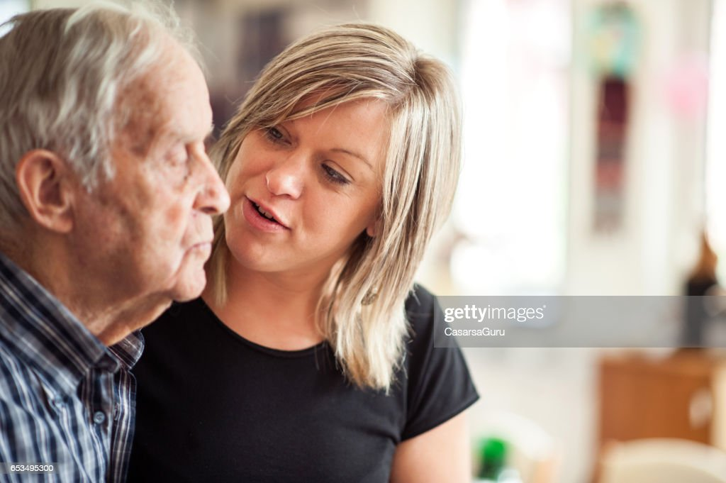 Assistant In The Community Center Helping A Senior Men : Stock Photo