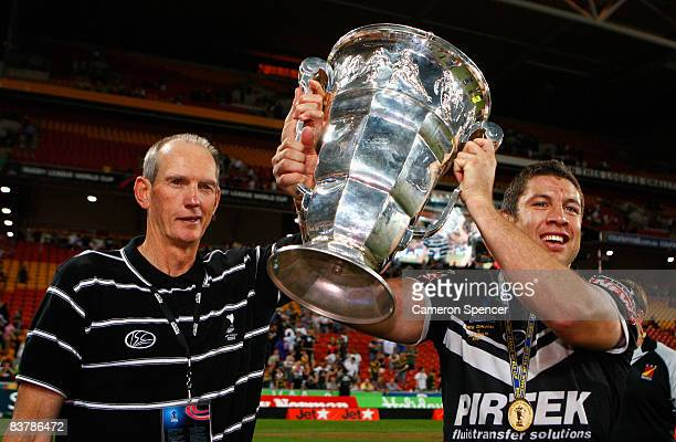 Assistant Kiwis coach Wayne Bennett and Kiwis captain Nathan Cayless hold aloft the world cup trophy after winning the 2008 Rugby League World Cup...