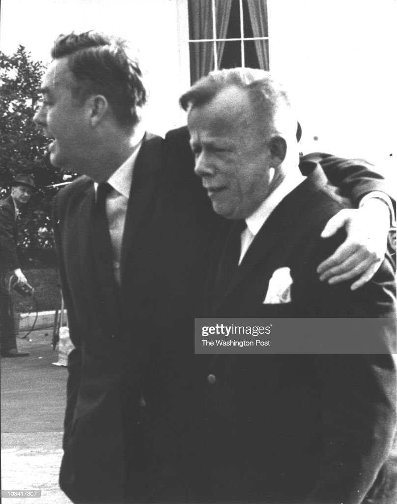 Assistant Labor Secretary Daniel Patrick Moynihan and artist William Walton leave the White House after learning that President John Kennedy had died. Photographed November 22, 1963 in Washington, DC.