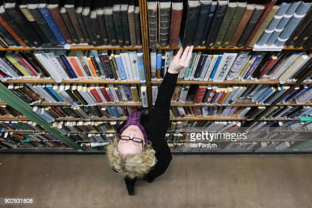 Assistant Librarian Anna Goodridge straightens bookshelves inside the Leeds Library on January 9 2018 in Leeds England This year sees the 250th...