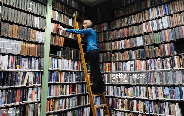 Assistant Librarian Helen Holdsworth arranges shelves of books inside the Leeds Library on January 9 2018 in Leeds England This year sees the 250th...