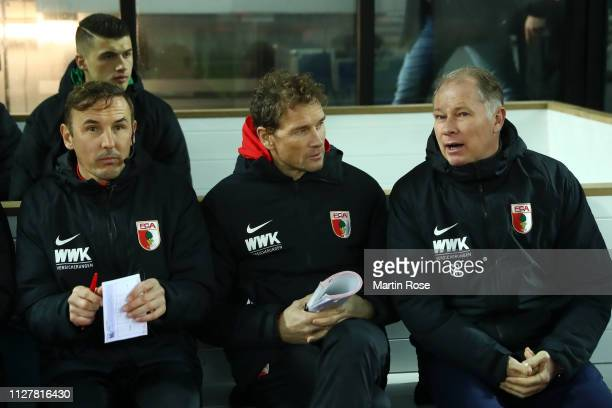 Assistant manager Jens Lehman and Sporting Director Stefan Reuter during the DFB Cup match between Holsein Kiel and FC Augsburg at HolsteinStadion on...