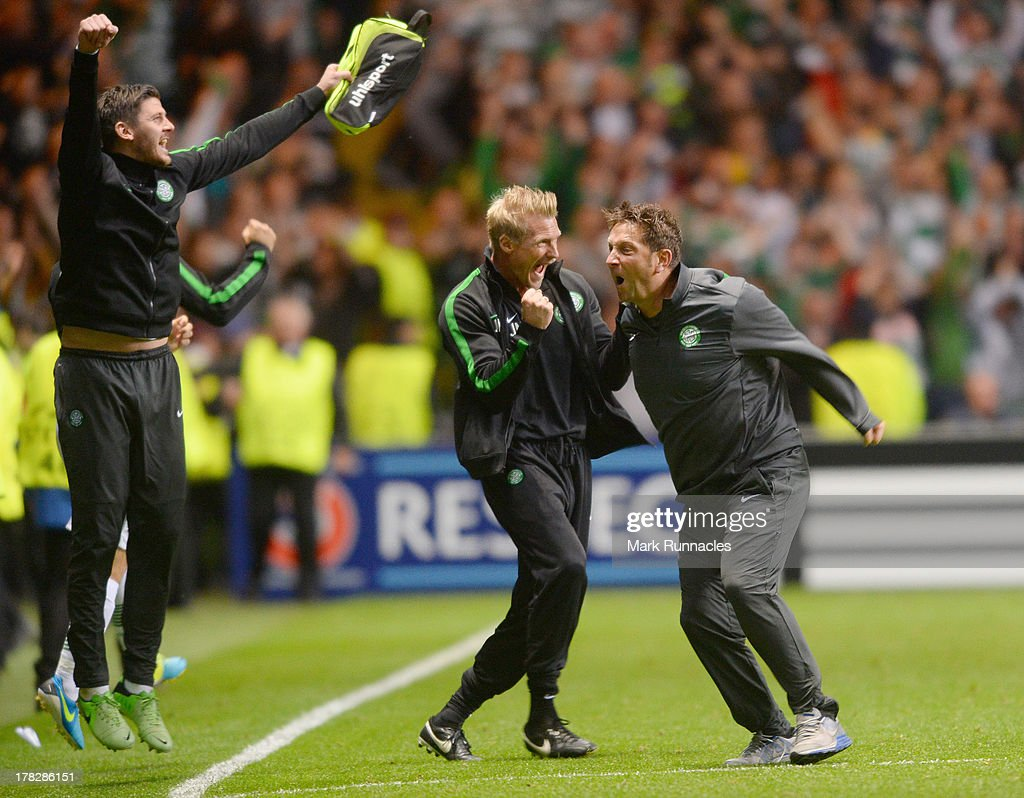 Assistant manager Johan Mjalby celebrates with fellow assistant Gary Park at the final whistle during the UEFA Champions League Play Off Round Second Leg match between Celtic and FC Shakhter Karagandy at Celtic Park Stadium on August 28, 2013 in Glasgow, Scotland.