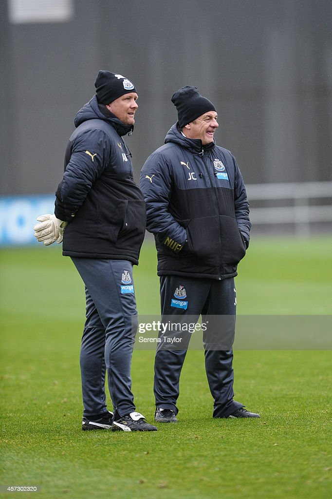Assistant Manager John Carver (R) and Goal Keeping Coach Andy Woodman (L) look on during a training session at The Newcastle United Training Centre on October 16, 2014, in Newcastle upon Tyne, England.