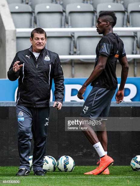 Assistant Manager John Carver gives instructions to Sammy Ameobi during a Newcastle United Training Session at StJames Park on August 29 in Newcastle...