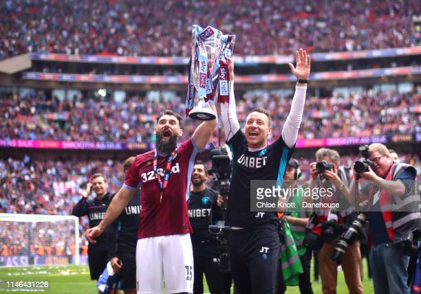 Assistant Manager John Terry and Mile Jedinak of Aston Villa lift the cup after winning the Sky Bet Championship Play-Off Final match between Aston...