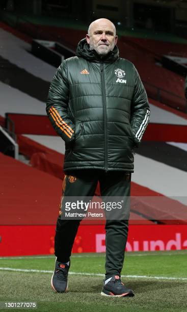 Assistant manager Mike Phelan of Manchester United walks out for the second half during The Emirates FA Cup Fifth Round match between Manchester...